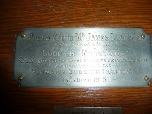 The plaque on the desk.